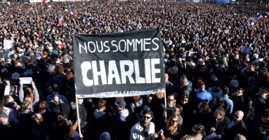 648x415_people-hold-a-banner-reading-in-french-we-are-charlie-during-a-march-to-honor-the-victims-of-the.jpg